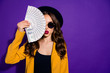 canvas print picture - Close-up portrait of her she nice lovely confident content rich wealthy wavy-haired lady closing half face with large budget sum pout lips isolated over bright vivid shine violet lilac background