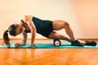 Leinwanddruck Bild - Woman Massaging Legs with Foam Roller