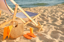 Chair With Bag And Accessories On Sand Beach