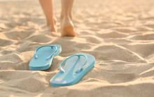 Flip-flops On Sand Beach At Re...