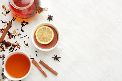 Composition with hot tea on light background