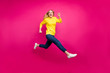 Full body photo of jumping high lady running sale shopping wear casual outfit isolated pink background