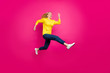Full size photo of crazy lady jumping high running shopping wear casual outfit isolated pink background