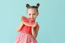 Cute Little Girl With Slice Of Fresh Watermelon On Color Background