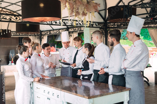 Fotografie, Obraz  Restaurant manager and his staff in terrace