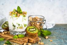 Kiwi Parfait Dessert In Glass With Ingredients.
