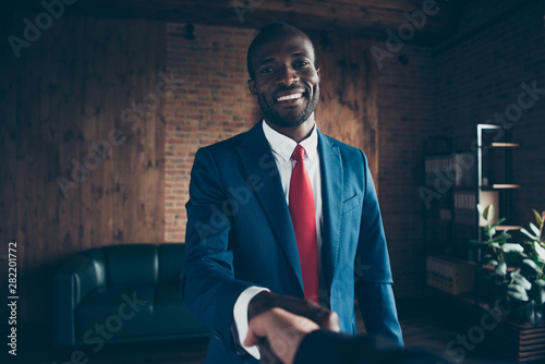 Foto  Photo of dark skin guy meet new candidate for interview wear elegant costume sit