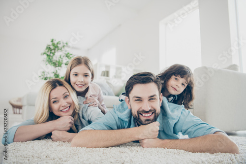 Fotografiet Photo of four members adopted family lying floor toothy smiling fluffy carpet co
