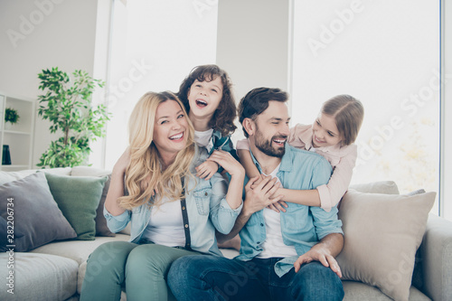 Photo of four family members spend time rejoicing giggle piggy back position sit couch living room - fototapety na wymiar