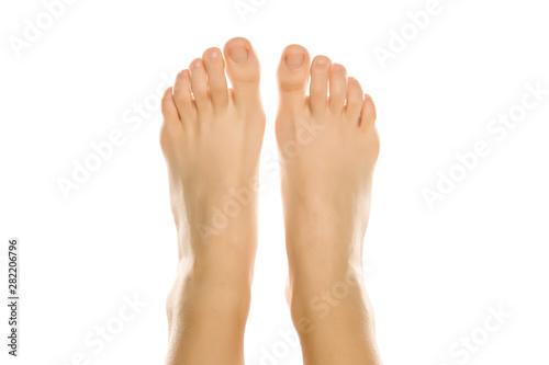 Young woman's beautiful bare feet and toes top view Canvas-taulu