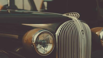 Retro car show background. Classic car's details close-up