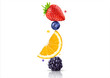 Leinwandbild Motiv A stack of fresh ripe summer fruits and berries isolated on white background. Blackberry, orange, blueberry, strawberry fruit stack in a row. Healthy life, balanced diet composition design concept