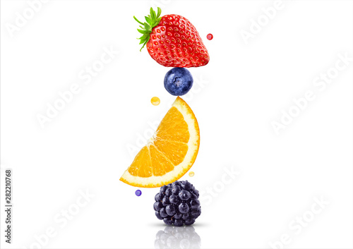 A stack of fresh ripe summer fruits and berries isolated on white background. Blackberry, orange, blueberry, strawberry fruit stack in a row. Healthy life, balanced diet composition design concept - 282210768