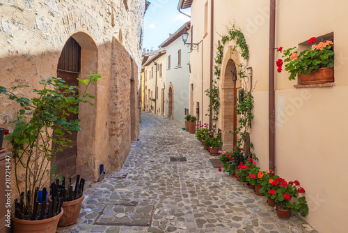 Fototapeten Schmale Gasse Nocera Umbra (Italy) - A little charming stone medieval city on the hill, with suggestive alley and square, in province of Perugia. Here a view of historical center.
