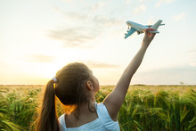 Child Girl Holding Airplane To...