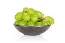 Lot Of Whole Fresh Green Grape In Dark Ceramic Bowl Isolated On White Background