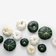 White And Green Pumpkins On A White Background, Creative Flat Lay Thanksgiving Concept, Top View With Copy Space
