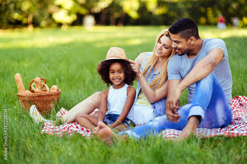 Canvas Prints Height scale Picture of lovely couple with their daughter having picnic