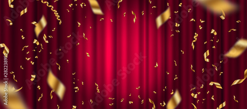 Fotografía  Spotlight on red curtain background and falling golden confetti