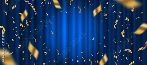 Fotografiet Spotlight on blue curtain background and falling golden confetti