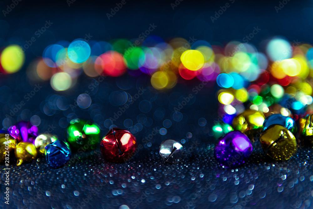 Fototapety, obrazy: Multi-colored Christmas jingle bells. Blue filter. Blurred bokeh background.