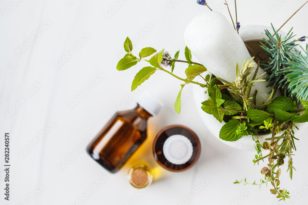 Fototapeta Bottles of essential oil, white background. Healthy cosmetics concept.