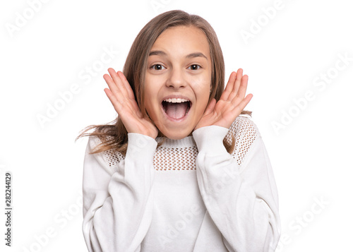 Photo Surprised happy young teen girl, isolated on white background