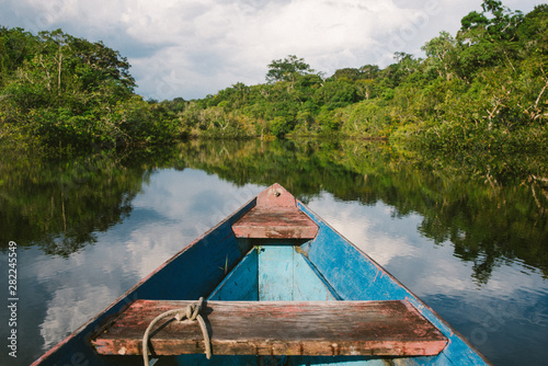 Canoeing through the flooded Amazon Jungle Canvas Print
