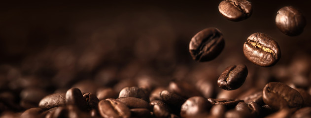 Coffee Beans Closeup On Dark Background
