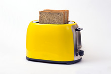 Yellow Toaster On A White Background