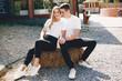 Leinwandbild Motiv Cute couple in a park. Lady in a white t-shirt.