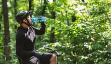 Male Cyclist Sitting On Bike A...
