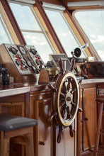 Detail Of The Ships Wood Wheel And Instrument Panel On A Motorboat.