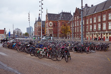 Large Bicycle Parking At Central Train Station In Amsterdam