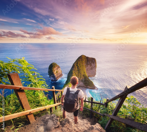 Foto auf AluDibond Cappuccino Traveler look at the ocean and rocks. Travel and active life concept. Adventure and travel on Bali, Indonesia. Travel - image