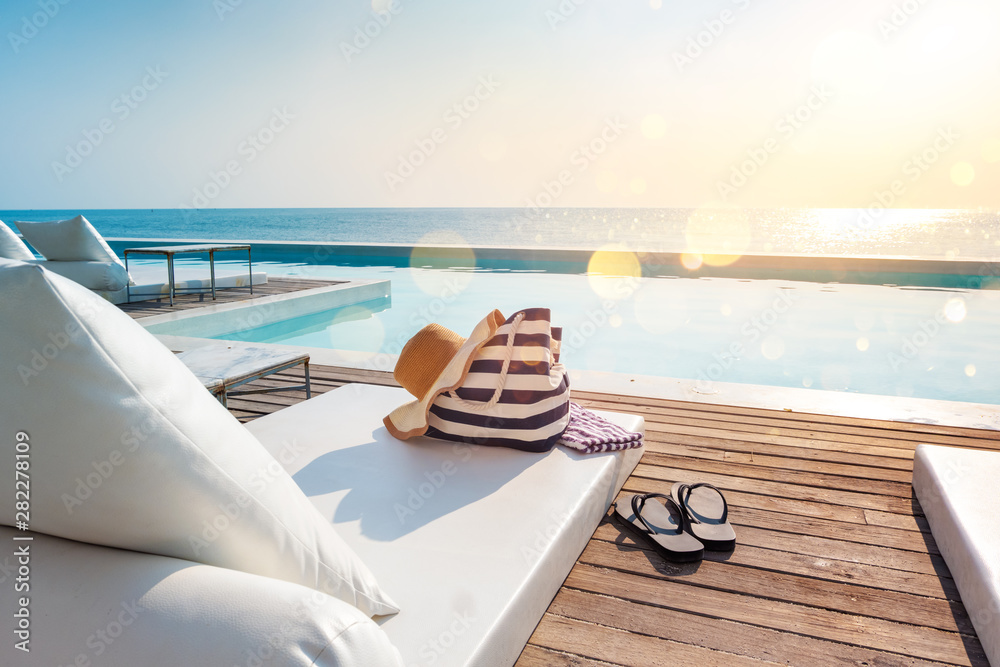 Fototapeta beach bag and hat on chair beach with sea view