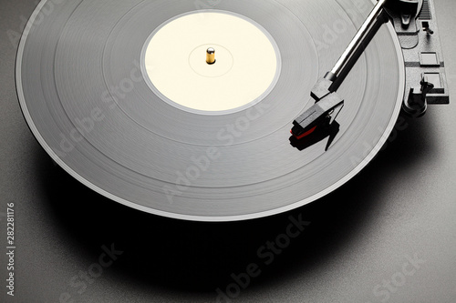 Photo sur Toile Nature Black vinyl record player on black table background