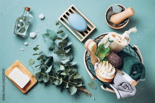 Obraz Wooden soap dish, soap, eucalyptus over green background. Zero waste, natural organic bathroom tools. Plastic free life. Ecological skin care, body treatment concept - fototapety do salonu
