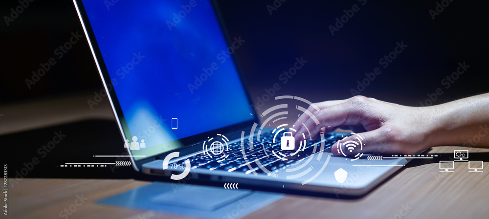 Fototapeta Close up businessman hand typing or working on laptop for programming about cyber security , advance future technology concept