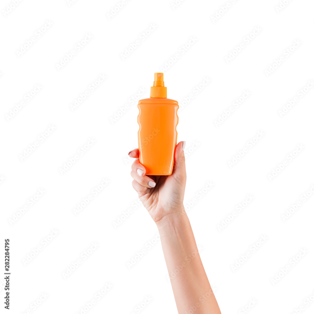 Fototapety, obrazy: Female hand holding cream bottle of lotion isolated. Girl give cosmetic products on white background