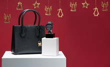 Christmas Fashion Concept With Women Accessories Hand Bag And Man Arm Watch On Red Background And Christmas Deco