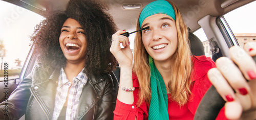 Fotografie, Obraz fun in car girl friends driving having fun and laughing