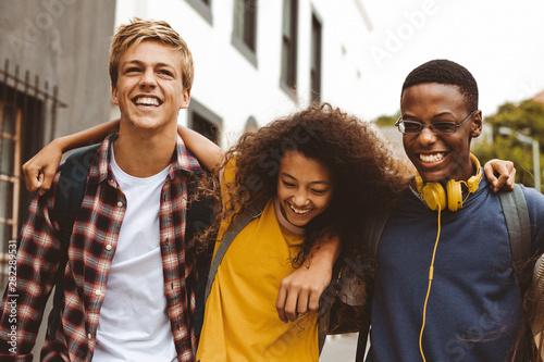 Obraz Teenage friends having fun outdoors - fototapety do salonu