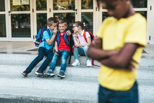 Schoolchildren Isolation At Primary School And Bullying Concept.