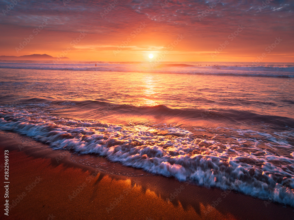 Fototapety, obrazy: beautiful red sunset on beach with a wave on the shore