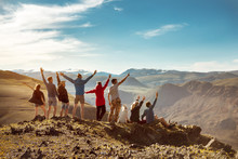 Big Group Happy Friends Or Tourists In Mountains