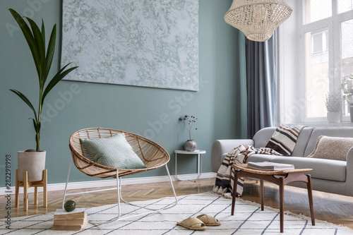 Bohointerior design of living room with sofa and rattan armchair Poster Mural XXL