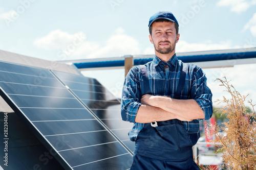 Obraz Young successful master of solar panel installation - fototapety do salonu