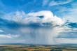 Leinwanddruck Bild Beautiful rain cloud and rain over the fields. Aerial photography.