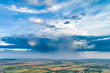 Leinwandbild Motiv Beautiful rain cloud and rain over the fields. Aerial photography.